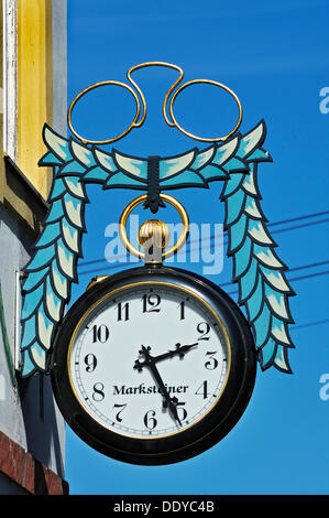 Pair of pince-nez and a pocket watch, hanging sign for an optician and watchmaker in Kochel am See, Bavaria - Stock Photo