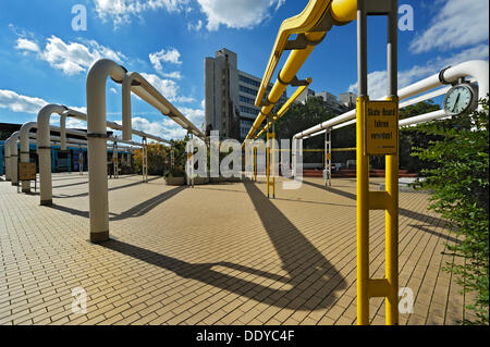 A multistorey building and supply pipes in the former Olympic Village, Munich, Bavaria - Stock Photo