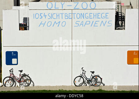 Protest slogan on a wall, in the former Olympic Village, Munich, Bavaria - Stock Photo