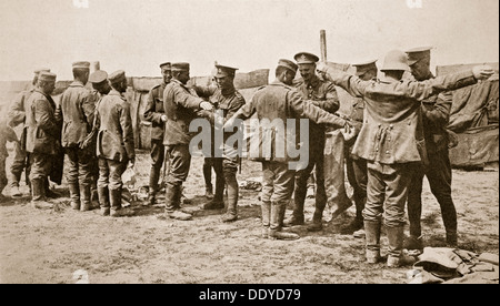 British soldiers searching captured German prisoners, Somme campaign, France, World War I, 1916. Artist: Unknown - Stock Photo
