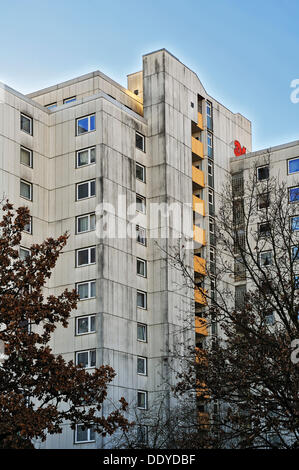High-rise residential apartment building from the seventies in the satellite city of Neuperlach, Munich, Bavaria - Stock Photo