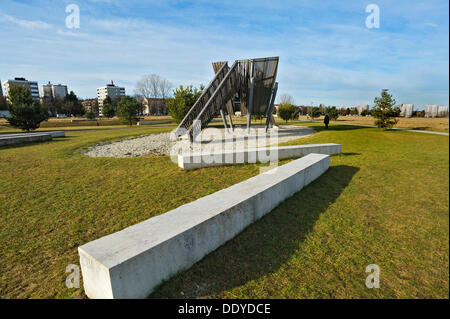 Concrete benches and a slide on a playground - Stock Photo