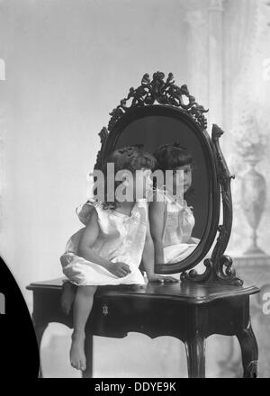 Posed portrait of a girl by a mirror, Landskrona, Sweden, 1910. Photographed in Carl Christersson's studio. From - Stock Photo