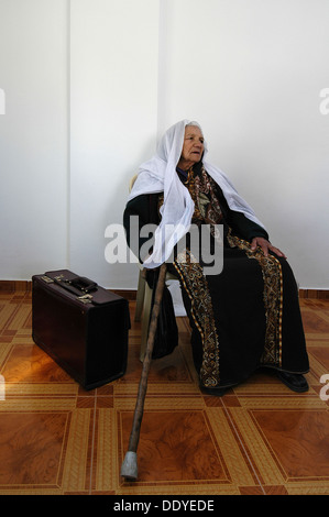 An elderly Palestinian woman wearing traditional Hijab headscarf and a Palestinian garment in the West Bank Israel - Stock Photo