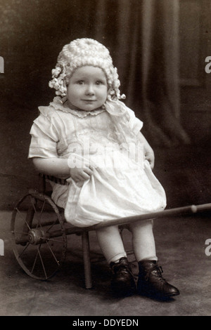 A little girl in a cart, c1910. From the Landskrona Museum Collection. - Stock Photo