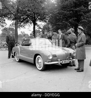 Young men admire the new Volkswagen Karmann Ghia, Landskrona, Sweden, 1955. From the Landskrona Museum Collection. - Stock Photo