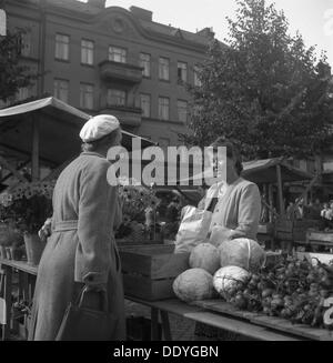 Fruit and vegetable stall in the market, Malmö, Sweden, 1947. - Stock Photo