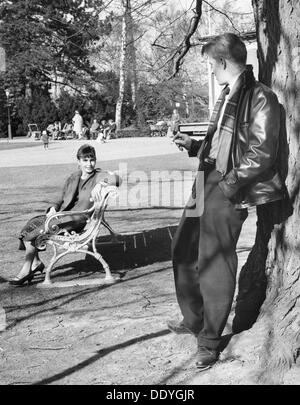 A flirt in the park, Trelleborg, Sweden, 1960. From the Trelleborgs Museum Collection. - Stock Photo