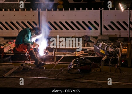 Nocturnal welding works on the track bed of a tram, Munich, Bavaria - Stock Photo