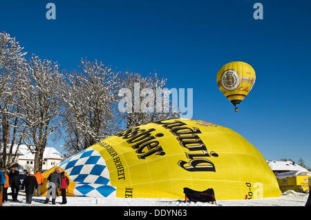 Balloons in the air or balloon envelope being inflated on the ground, 12th balloon festival of Tegernsee, Montgolfiade - Stock Photo