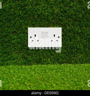 Electrical Plug Socket On Grass Background. - Stock Photo