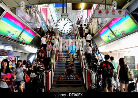 Train commuters getting out at Siam BTS Skytrain Station in Bangkok - Stock Photo