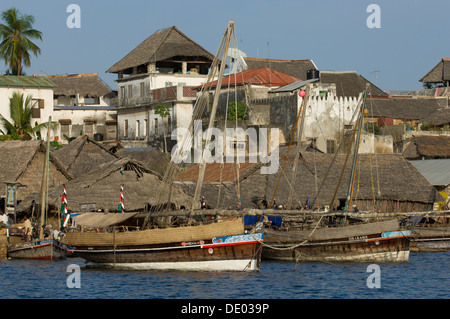 Dhows moored on the waterfront of Lamu Town, Lamu, Kenya - Stock Photo