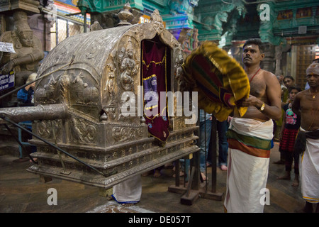 Nightly ritual where priests carry an idol of Parvati (Meenakashi) in a silver litter to spend the night with Shiva - Stock Photo