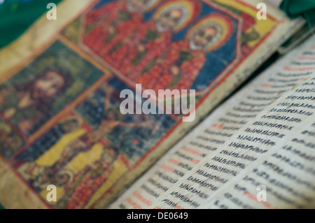Ancient illuminated bible, written in the Ge'ez , in the new St Mary of Zion Church, Axum, Ethiopia - Stock Photo