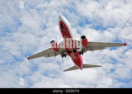 Passenger aircraft of AirBerlin, landing - Stock Photo