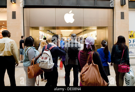 A crowd of people outside the Apple Store, Grand Arcade, Cambridge UK - Stock Photo