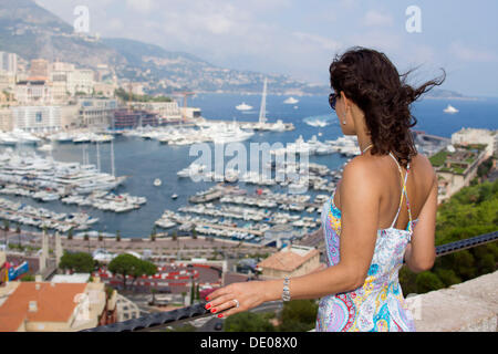 Woman looking over the marina - Stock Photo