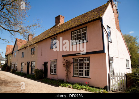 Traditional pink painted terraced houses in the village of Stoke By Clare, Suffolk East Anglia, England UK - Stock Photo