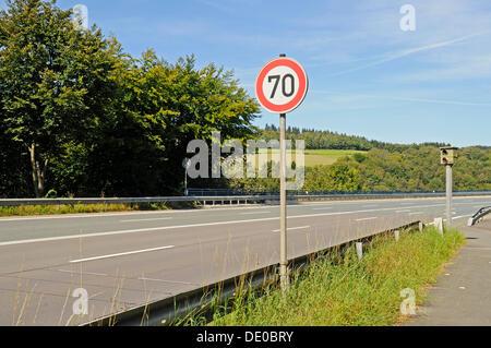Traffic sign, 70 kmh speed limit, Speed limit enforcement, traffic control, country road, Talbruecke Ronnewinkel - Stock Photo