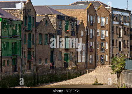 London Docklands Old Warehouse Buildings Along River Thames With - warehouses london