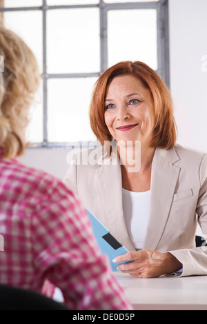 Personnel manager during an interview with a trainee - Stock Photo