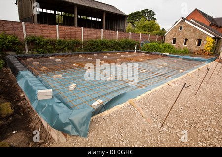 self building house, preparing site, steel mesh reinforced prepared base for floor slab pouring - Stock Photo