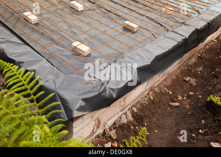 self building house, preparing site, steel mesh reinforced prepared base ready for floor slab pouring - Stock Photo