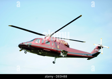 The royal family's helicopter also known as the Queen's Helicopter Flight (TQHF) G-XXEA - Stock Photo