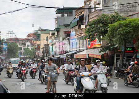 Motorcycle traffic in Hanoi downtown, Hanoi, Vietnam - Stock Photo