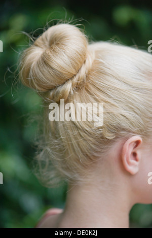 Woman's hair arranged in a chignon - Stock Photo