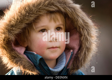 Girl, 3, wearing a hood, portrait - Stock Photo