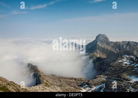 Low stratus as seen from Saentis mountain, view of Altmann mountain, Alpstein mountain group, Appenzell, Switzerland, - Stock Photo