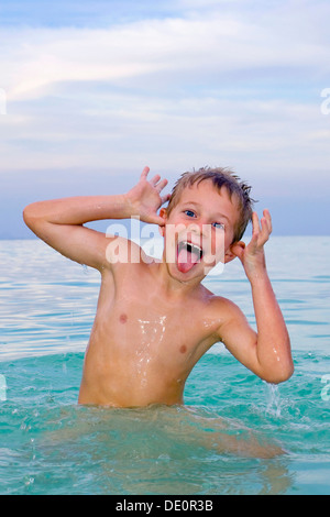 Boy, 6 years old, swimming in the sea, playful - Stock Photo