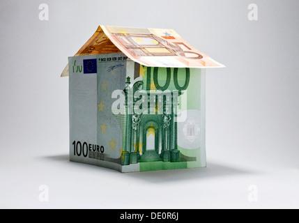 House made of banknotes, symbolic image - Stock Photo