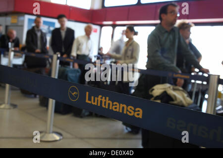 Passengers waiting at the airport, delays and canceled flights due to the strike of the Lufthansa flight attendants - Stock Photo