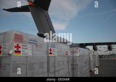 Relief supplies in front of an Airbus A400M Atlas, ILA Berlin Air Show, Berlin - Stock Photo