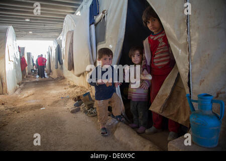 Children in a camp for Syrian refugees of the civil war near the Turkish border - Stock Photo