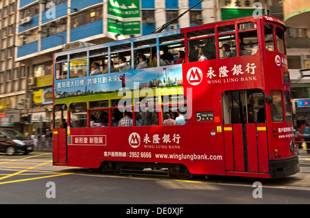 Double-deck tramcar of Hong Kong Tramways with tram body advertising, Hong Kong - Stock Photo