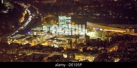 Aerial view, EON headquarters next to Messe Essen, trade fair area, at night - Stock Photo