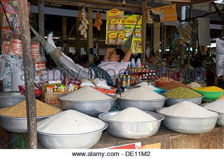 Saleswoman in hammock and rice on sale, Nha Trang, Vietnam, Southeast Asia - Stock Photo