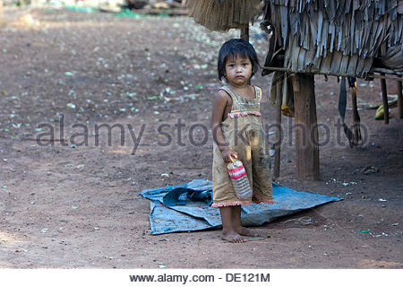 Little girl in a village, Cambodia, Southeast Asia - Stock Photo