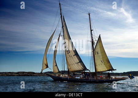 A double-gaff ketch under sail. - Stock Photo