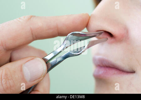 Examination of nose by ear, nose and throat specialist - Stock Photo