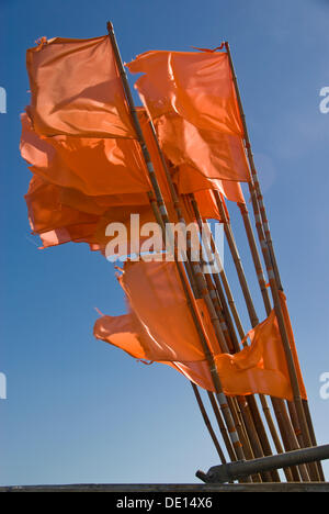 Marking flags on fishing boat in the wind, Denmark, Europe - Stock Photo