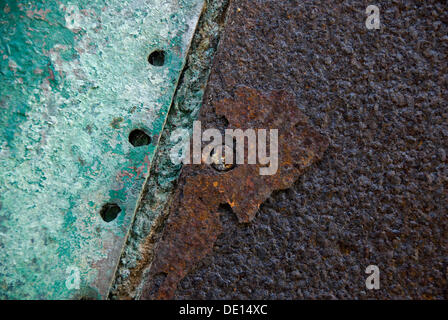 Green paint and rust on a metal plate - Stock Photo