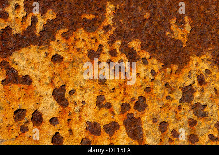 Metal surface with rust and remains of paint, detailed view - Stock Photo