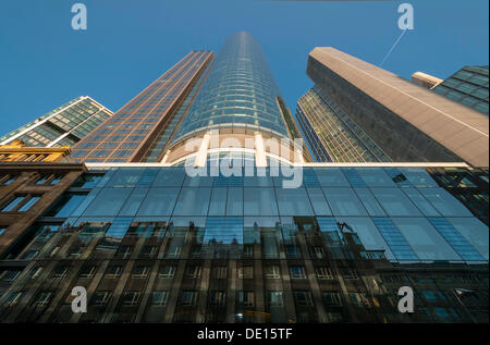 Row of houses being reflected on facade of the Main Tower, Garden Tower on right, Innenstadt/Bankenviertel, Frankfurt - Stock Photo