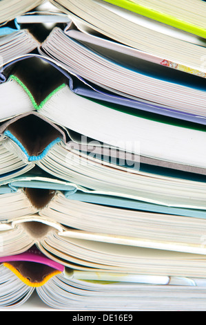 A pile of hardback books on top of each other - Stock Photo