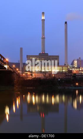 Coal-fired EnBW cogeneration plant in Stuttgart-Gaisburg on the Neckar River, on the left, the bridge over the Neckar - Stock Photo
